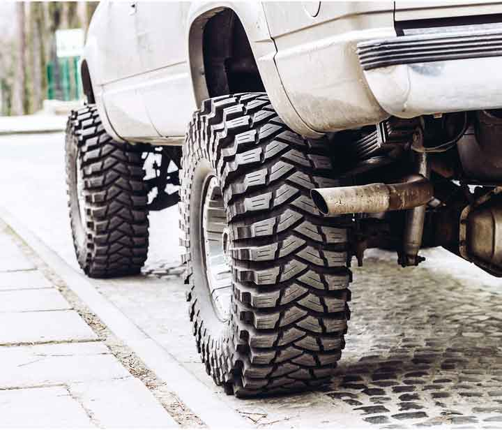 white truck with raised suspension